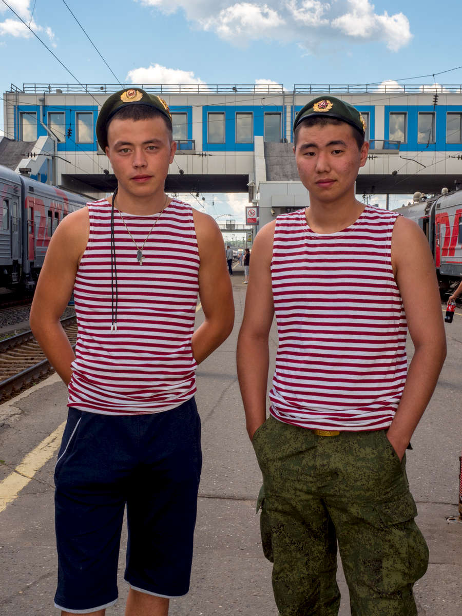 Two young soldiers in transit on the Trans-Siberian Railway from Moscow-Vladivostok. Spanning a length of 9,289km, it's the longest uninterrupted single country train journey in the world. It has connected Moscow with Vladivostok since 1916, and is still being expanded. It was built between 1891 and 1916 under the supervision of Russian government ministers personally appointed by Tsar Alexander III and his son, the Tsarevich Nicholas (later Tsar Nicholas II).