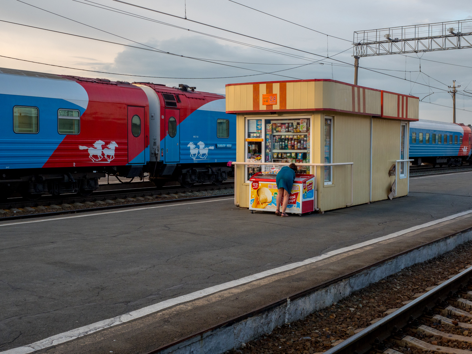 A platform shop providing supplies for passengers on the Trans-Siberian Railway from Moscow-Vladivostok,. Spanning a length of 9,289km, it's the longest uninterrupted single country train journey in the world. It has connected Moscow with Vladivostok since 1916, and is still being expanded. It was built between 1891 and 1916 under the supervision of Russian government ministers personally appointed by Tsar Alexander III and his son, the Tsarevich Nicholas (later Tsar Nicholas II).
