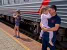 A woman poses wearing a conductors hat and a father comforts his daughter during a stop on the Trans-Siberian Railway from Moscow-Vladivostok. Spanning a length of 9,289km, it's the longest uninterrupted single country train journey in the world. It has connected Moscow with Vladivostok since 1916, and is still being expanded. It was built between 1891 and 1916 under the supervision of Russian government ministers personally appointed by Tsar Alexander III and his son, the Tsarevich Nicholas (later Tsar Nicholas II).