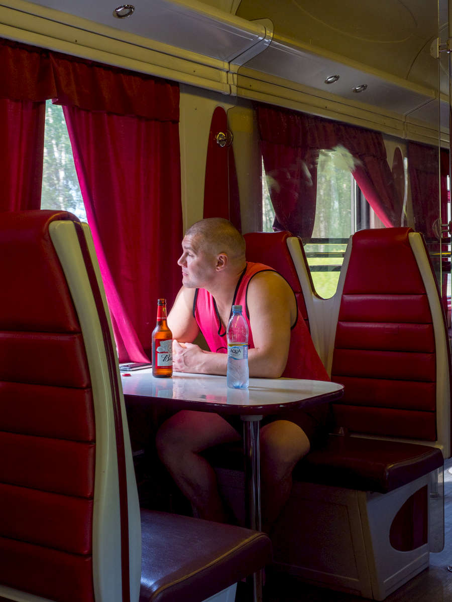 A passenger drinks a beer in the restaurant on the Trans-Siberian Railway from Moscow-Vladivostok. Spanning a length of 9,289km, it's the longest uninterrupted single country train journey in the world. It has connected Moscow with Vladivostok since 1916, and is still being expanded. It was built between 1891 and 1916 under the supervision of Russian government ministers personally appointed by Tsar Alexander III and his son, the Tsarevich Nicholas (later Tsar Nicholas II).