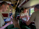 Army recruits play cards in a third class carriage on the Trans-Siberian Railway from Moscow-Vladivostok. Spanning a length of 9,289km, it's the longest uninterrupted single country train journey in the world. It has connected Moscow with Vladivostok since 1916, and is still being expanded. It was built between 1891 and 1916 under the supervision of Russian government ministers personally appointed by Tsar Alexander III and his son, the Tsarevich Nicholas (later Tsar Nicholas II).
