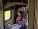 A young woman sat in third class on the Trans-Siberian Railway from Moscow-Vladivostok. Spanning a length of 9,289km, it's the longest uninterrupted single country train journey in the world. It has connected Moscow with Vladivostok since 1916, and is still being expanded. It was built between 1891 and 1916 under the supervision of Russian government ministers personally appointed by Tsar Alexander III and his son, the Tsarevich Nicholas (later Tsar Nicholas II).