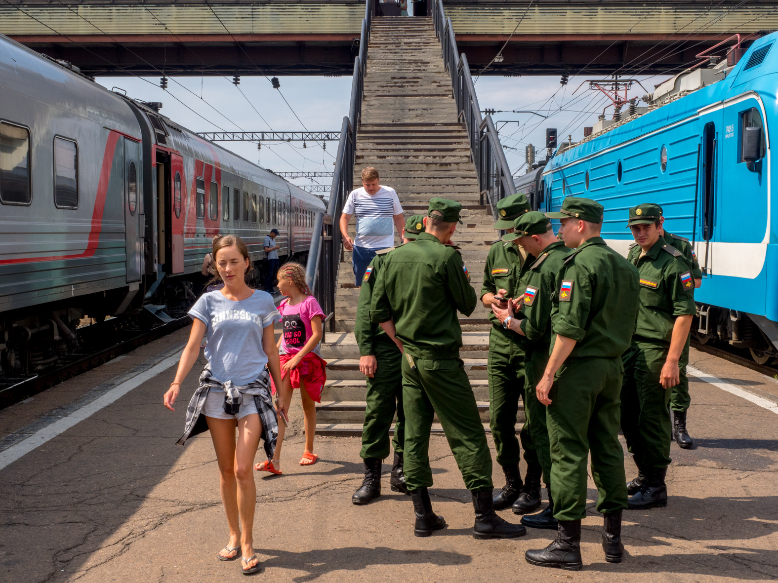 Soldiers and civilians during a station stop on the Trans-Siberian Railway from Moscow-Vladivostok. Spanning a length of 9,289km, it's the longest uninterrupted single country train journey in the world. It has connected Moscow with Vladivostok since 1916, and is still being expanded. It was built between 1891 and 1916 under the supervision of Russian government ministers personally appointed by Tsar Alexander III and his son, the Tsarevich Nicholas (later Tsar Nicholas II).