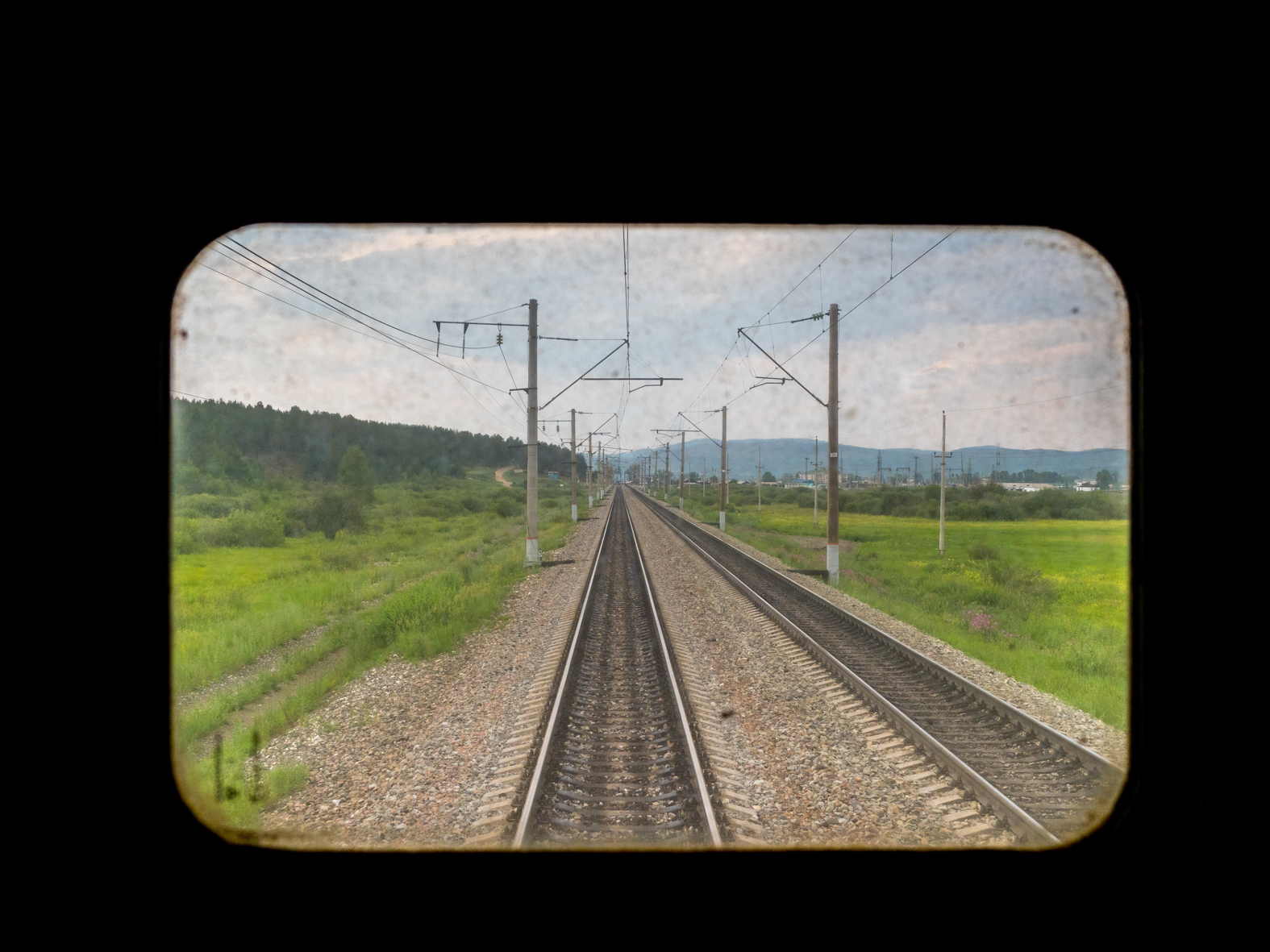 A view from back of the Trans-Siberian Railway from Moscow-Vladivostok. Spanning a length of 9,289km, it's the longest uninterrupted single country train journey in the world. It has connected Moscow with Vladivostok since 1916, and is still being expanded. It was built between 1891 and 1916 under the supervision of Russian government ministers personally appointed by Tsar Alexander III and his son, the Tsarevich Nicholas (later Tsar Nicholas II).