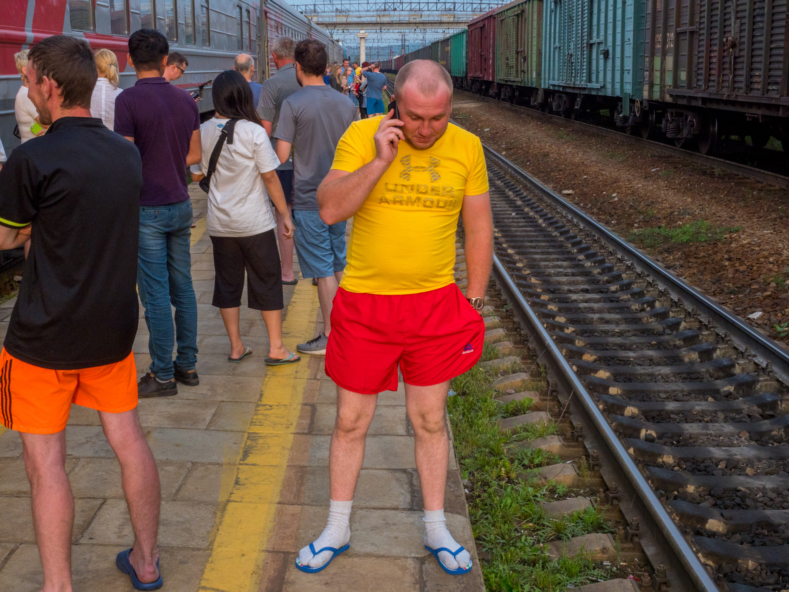 Passengers stretch their legs during a scheduled stop on the Trans-Siberian Railway from Moscow-Vladivostok. spanning a length of 9,289km, it's the longest uninterrupted single country train journey in the world. It has connected Moscow with Vladivostok since 1916, and is still being expanded. It was built between 1891 and 1916 under the supervision of Russian government ministers personally appointed by Tsar Alexander III and his son, the Tsarevich Nicholas (later Tsar Nicholas II).