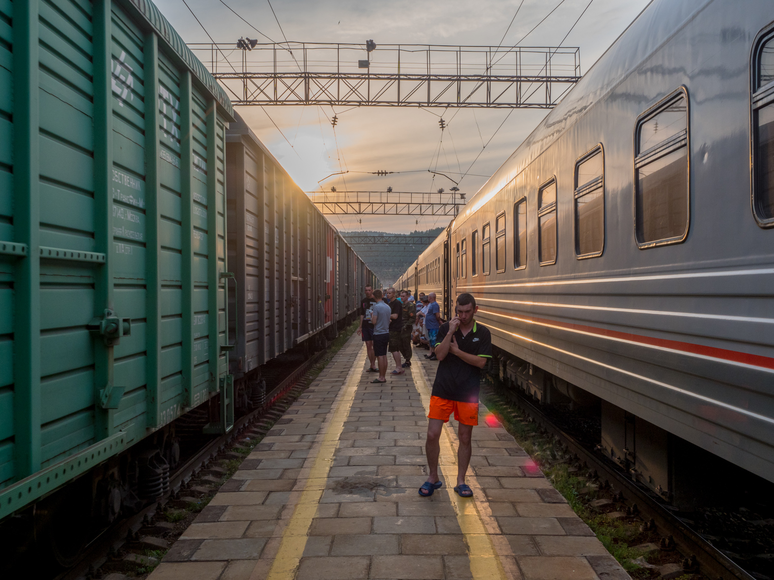 Passengers socialise and stretch their legs during a scheduled stop on the Trans-Siberian Railway from Moscow-Vladivostok. Spanning a length of 9,289km, ist' the longest uninterrupted single country train journey in the world. It has connected Moscow with Vladivostok since 1916, and is still being expanded. It was built between 1891 and 1916 under the supervision of Russian government ministers personally appointed by Tsar Alexander III and his son, the Tsarevich Nicholas (later Tsar Nicholas II).