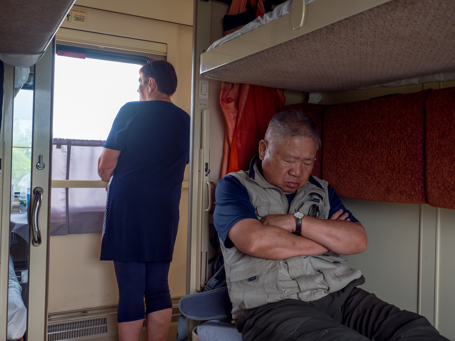 67 year old Korean egineer, Chong, asleep on his bunk. The Trans-Siberian Railway from Moscow-Vladivostok, spanning a length of 9,289km, is the longest uninterrupted single country train journey in the world. It has connected Moscow with Vladivostok since 1916, and is still being expanded. It was built between 1891 and 1916 under the supervision of Russian government ministers personally appointed by Tsar Alexander III and his son, the Tsarevich Nicholas (later Tsar Nicholas II).