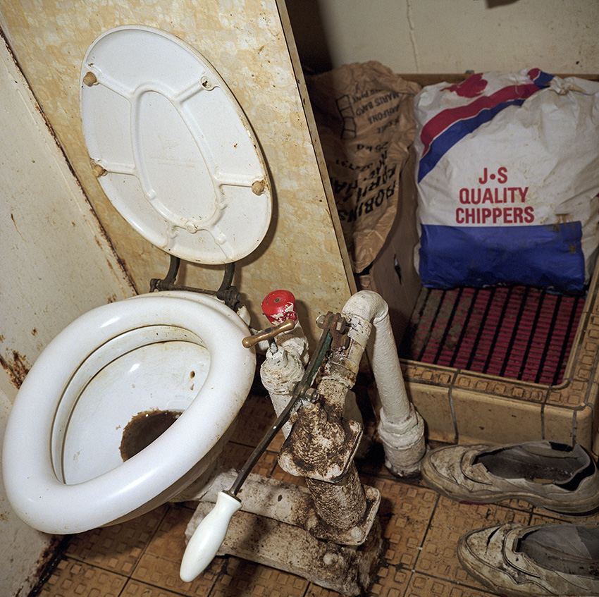 The Allegiance toilet also doubles as the cooks larder. Urination is conducted directly into the sea with the lavatory reserved for solid deposits.In 1999, Photojournalist Peter Dench spent five days onboard The Allegiance, a 60 foot UK Scarborough-based trawler, fishing the North Sea, with a crew of five.  The future has since become extremely bleak for the English trawler men; huge areas of the North Sea have been declared \'off limits\' and fishing quotas have been slashed in an attempt to rescue dwindling North Sea stocks from the point of extinction.  These measures have jeopardised the jobs of those in the industry and put dependent towns, like Scarborough, on the brink of ruin.Dench returned to The Allegiance in 2005 to be reunited with the crew and to find out how the decline of the North Sea fishing industry has affected their lives.
