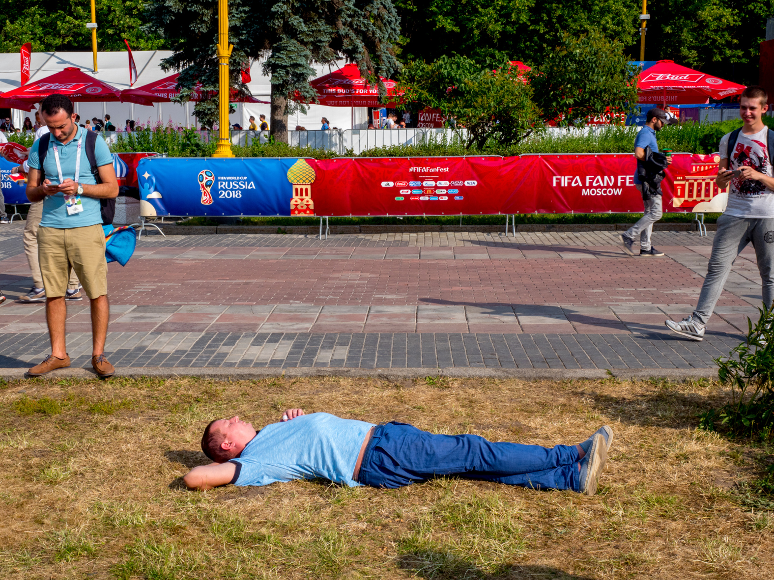 A football fan takes a break.The FIFA Fan Fest located at Vorobyovy Gory (Sparrow Hills) Moscow, has a venue Capacity of 25,000. The site provides a spectacular view down the hill, directly towards Luzhniki Stadium and Moscow City. The 21st FIFA World Cup football tournament took place in Russia in 2018. It was the first World Cup to be held in Eastern Europe and the eleventh time that it has been held in Europe. For the first time the tournament took place on two continents – Europe and Asia. All but two of the stadium venues were in European Russia.