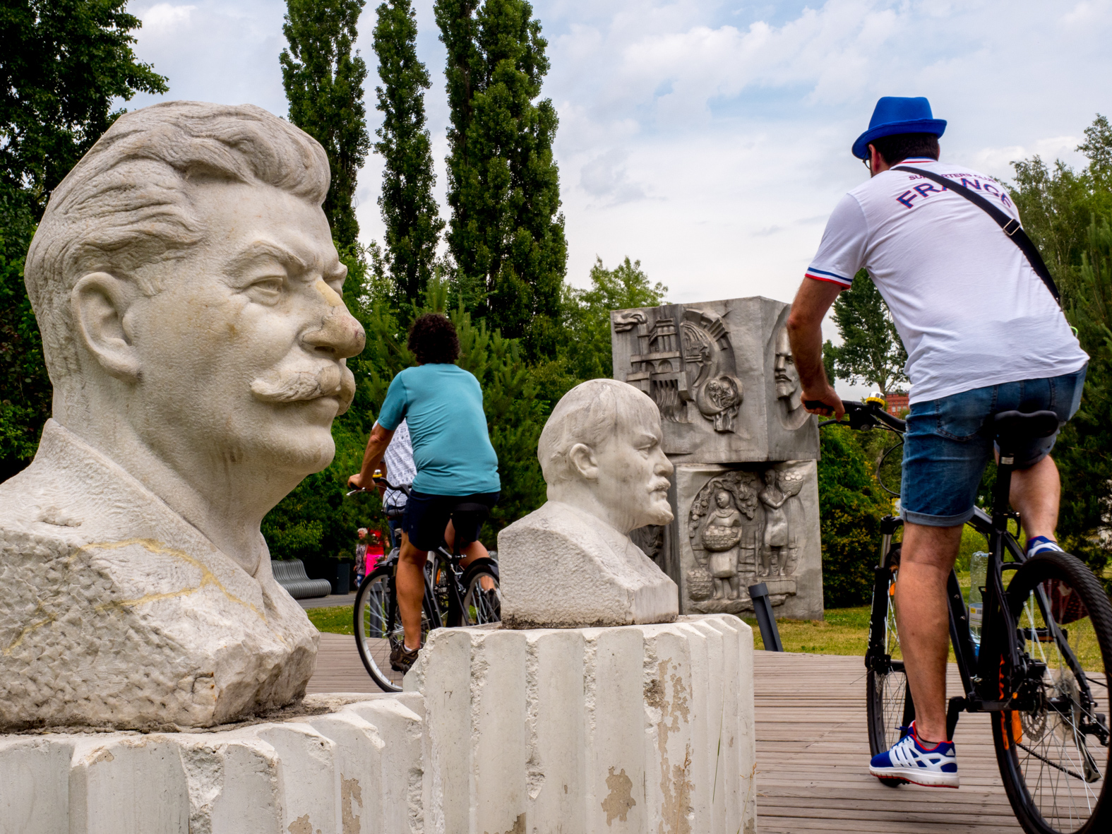 Supporters club France members cycle through a Soviet sculpture park located at Sssr Oplot Mira, Moscow. Vladimir Ilyich Ulyanov, better known by the alias Lenin, was a Russian communist revolutionary, politician and political theorist. He served as head of government of Soviet Russia from 1917 to 1924 and of the Soviet Union from 1922 to 1924. The 21st FIFA World Cup football tournament took place in Russia in 2018. It was the first World Cup to be held in Eastern Europe and the eleventh time that it has been held in Europe. For the first time the tournament took place on two continents – Europe and Asia. All but two of the stadium venues were in European Russia.