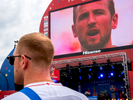 England captain, Harry Kane, featured singing the English national anthem on a big screen at FIFA Fan Fest.  The Moscow FIFA Fan Fest located at Vorobyovy Gory (Sparrow Hills) with a venue Capacity of 25,000. The site provides a spectacular view down the hill, directly towards Luzhniki Stadium and Moscow City. The 21st FIFA World Cup football tournament took place in Russia in 2018. It was the first World Cup to be held in Eastern Europe and the eleventh time that it has been held in Europe. For the first time the tournament took place on two continents – Europe and Asia. All but two of the stadium venues were in European Russia.