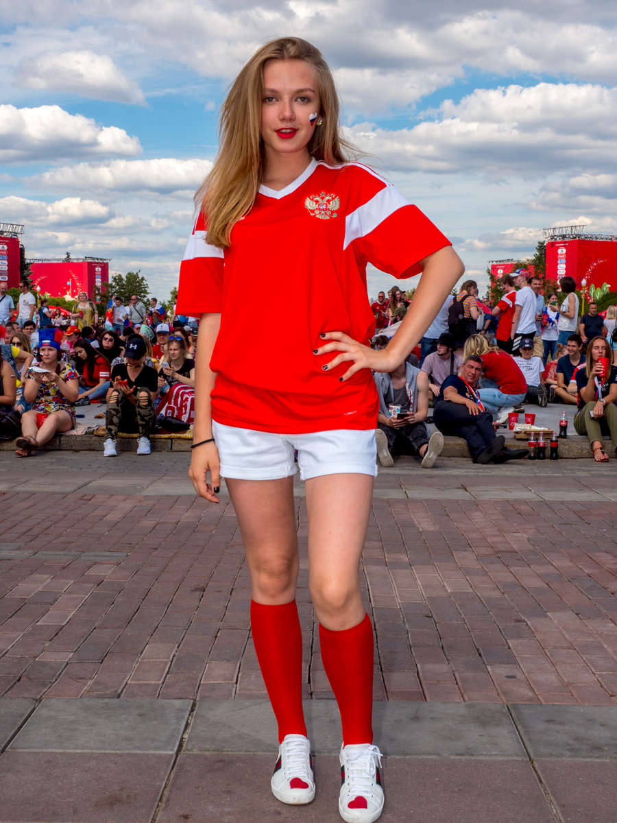 A Russian football fan at the Moscow FIFA Fan Fest located at Vorobyovy Gory (Sparrow Hills) with a venue Capacity of 25,000. The site provides a spectacular view down the hill, directly towards Luzhniki Stadium and Moscow City. The 21st FIFA World Cup football tournament took place in Russia in 2018. It was the first World Cup to be held in Eastern Europe and the eleventh time that it has been held in Europe. For the first time the tournament took place on two continents – Europe and Asia. All but two of the stadium venues were in European Russia.