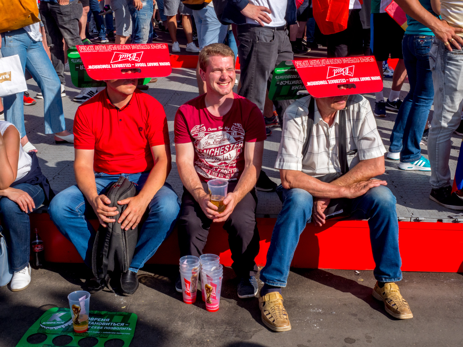 Football fans with makeshift sun shades at the Moscow FIFA Fan Fest located at Vorobyovy Gory (Sparrow Hills) with a venue Capacity of 25,000. The site provides a spectacular view down the hill, directly towards Luzhniki Stadium and Moscow City.The 21st FIFA World Cup football tournament took place in Russia in 2018. It was the first World Cup to be held in Eastern Europe and the eleventh time that it has been held in Europe. For the first time the tournament took place on two continents – Europe and Asia. All but two of the stadium venues were in European Russia.