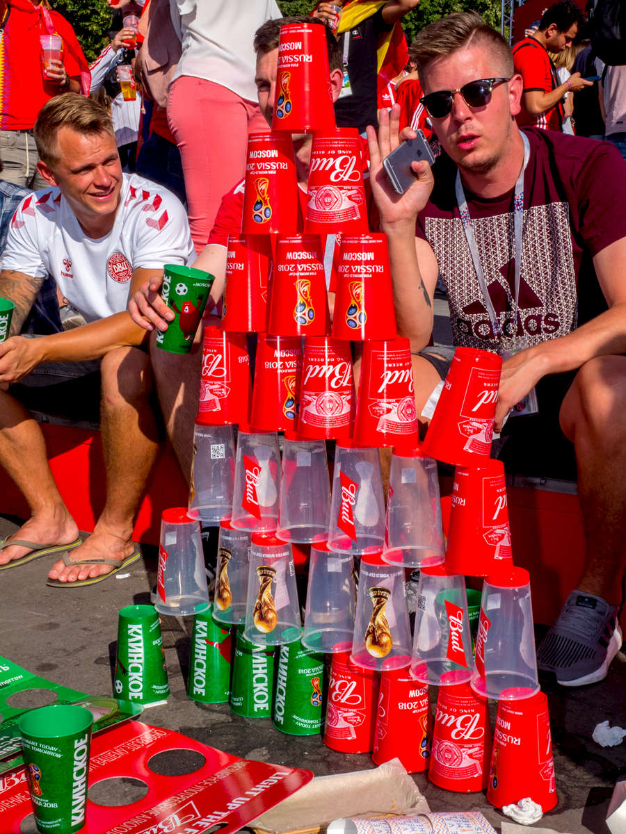Danis fans build a pyramid from empty beer cups at the Moscow FIFA Fan Fest located at Vorobyovy Gory (Sparrow Hills) with a venue Capacity of 25,000. The site provides a spectacular view down the hill, directly towards Luzhniki Stadium and Moscow City. The 21st FIFA World Cup football tournament took place in Russia in 2018. It was the first World Cup to be held in Eastern Europe and the eleventh time that it has been held in Europe. For the first time the tournament took place on two continents – Europe and Asia. All but two of the stadium venues were in European Russia.