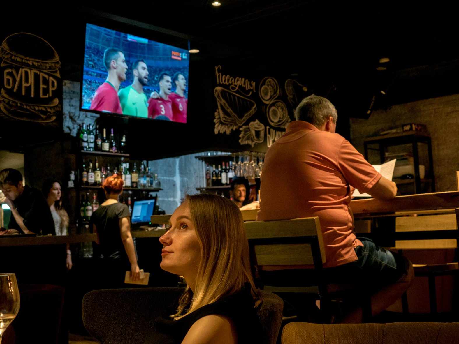 A woman watches a World Cup football match on the television in a bar. The 21st FIFA World Cup football tournament took place in Russia in 2018. It was the first World Cup to be held in Eastern Europe and the eleventh time that it has been held in Europe. For the first time the tournament took place on two continents – Europe and Asia. All but two of the stadium venues were in European Russia.