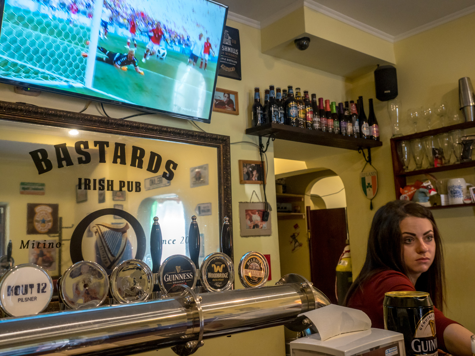 The BASTARDS IRISH PUB in the north west Moscow suburb of Mithino showing a match on TV. The 21st FIFA World Cup football tournament took place in Russia in 2018. It was the first World Cup to be held in Eastern Europe and the eleventh time that it has been held in Europe. For the first time the tournament took place on two continents – Europe and Asia. All but two of the stadium venues were in European Russia.