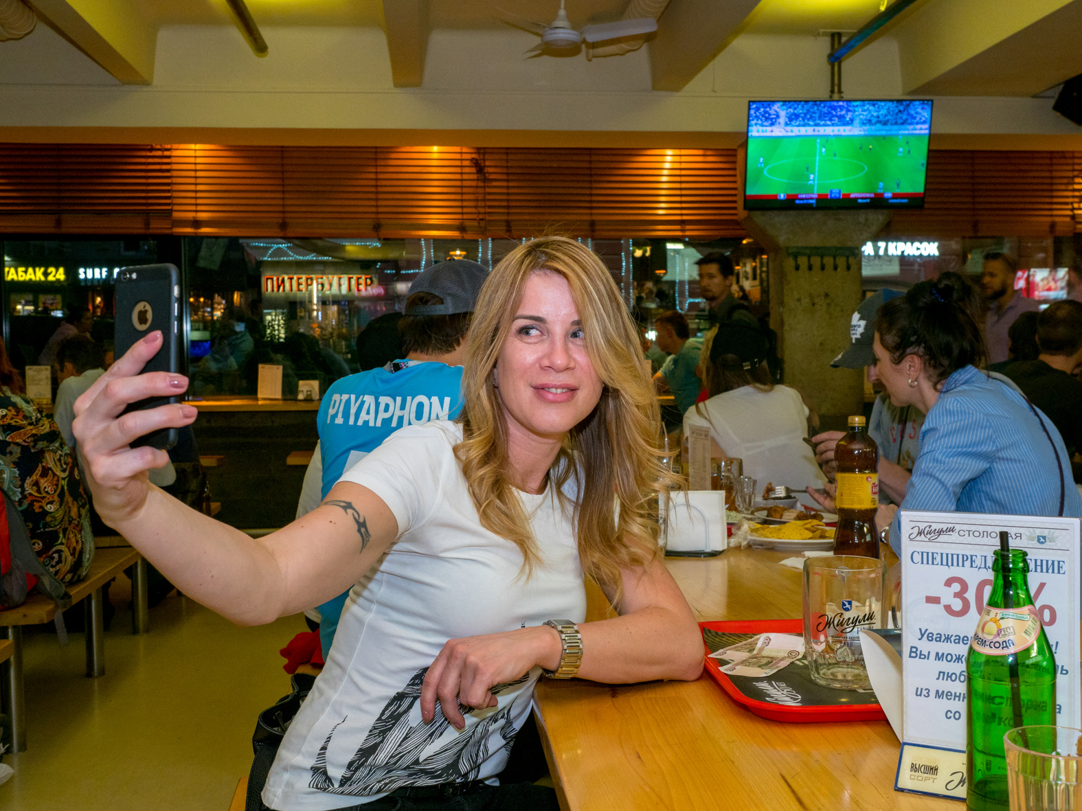 A woman takes a selfie in a Moscow bar during the Nigeria v Argentina match.The 21st FIFA World Cup football tournament took place in Russia in 2018. It was the first World Cup to be held in Eastern Europe and the eleventh time that it has been held in Europe. For the first time the tournament took place on two continents – Europe and Asia. All but two of the stadium venues were in European Russia.