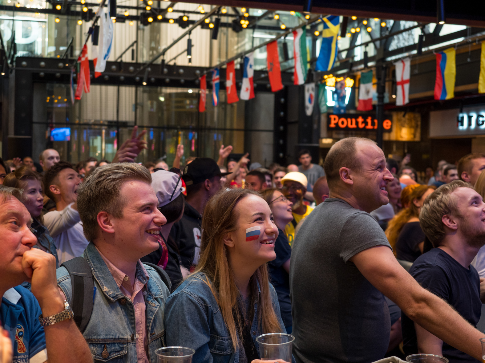 Football fans watch a match on a screen in a central Moscow bar. The 21st FIFA World Cup football tournament took place in Russia in 2018. It was the first World Cup to be held in Eastern Europe and the eleventh time that it has been held in Europe. For the first time the tournament took place on two continents – Europe and Asia. All but two of the stadium venues were in European Russia.
