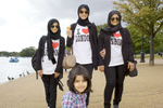 16-year-old Salma Mohammed, centre, is one Saudi Arabian who likes to visit the Serpentine lake in Hyde Park.Arabs have been visiting London for centuries and around 300,000 Arabs have chosen to make the capital their home and a further half a million throughout the UK. The number swells significantly from visitors during the summer. Saudi Arabians spend the most on property in London choosing Belgravia, Kenington, Knightsbridge and Holland Park. Arab culture continues to increase in visibility throughout the capital as integration into this most transient of city's continues.©Peter Dench/Reportage by Getty Images