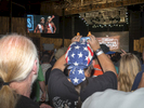 Supporters watch the finalists on stage at the Twin Peaks 2015 National Bikini Contest where around 68 girls from the USA competed for the crown for Miss Twin Peaks 2015, hosted at Gas Monkey Live Dallas, on the 24th June.Twin Peaks is a chain of sports bars and restaurants (colloquially referred to as breastaurants) based in Dallas, Texas. The chain is known for having its waitresses dress in revealing uniforms that consist of cleavage- and midriff-revealing red plaid (or sometimes black bikini) tops, as well as khaki short shorts. At other times, waitresses wear revealing seasonal or themed outfits. Restaurants are decorated in the theme of a wilderness lodge and serve a mix of American, Southwest and Southern cuisines as well as alcohol. The chain's slogan is {quote}Eats. Drinks. Scenic Views.{quote}Dallas is a major city in Texas and is the largest urban center of the fourth most populous metropolitan area in the United States. The city ranks ninth in the U.S. and third in Texas after Houston and San Antonio. The city's prominence arose from its historical importance as a center for the oil and cotton industries, and its position along numerous railroad lines.For two weeks in the summer of 2015, photographer Peter Dench visited Dallas to document the metroplex in his epic reportage, DENCH DOES DALLAS.Photographed using an Olympus E-M5 Mark II©Peter Dench/Getty Images Reportage
