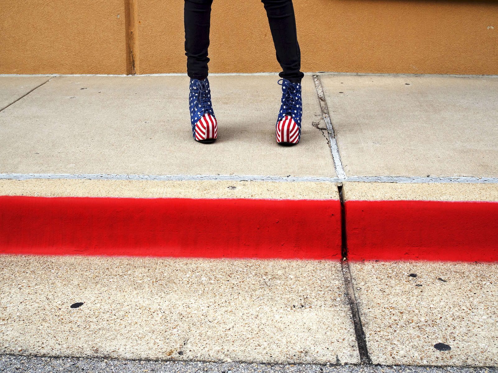 Patriotic footwear worn by Chloe on her way to work in Southlake.Southlake is an affluent city located north-west of Dallas in the U.S state of Texas with a population of arond 26,5700. Southlake was named in 2014 as one of TIME magazines top 10 richest towns in America a and is known for public schools, Southlake Town Square, its wealth, Gateway Church and Carroll High School's 8-time state champion football team.Dallas is a major city in Texas and is the largest urban center of the fourth most populous metropolitan area in the United States. The city ranks ninth in the U.S. and third in Texas after Houston and San Antonio. The city's prominence arose from its historical importance as a center for the oil and cotton industries, and its position along numerous railroad lines.For two weeks in the summer of 2015, photographer Peter Dench visited Dallas to document the metroplex in his epic reportage, DENCH DOES DALLAS.Photographed using an Olympus E-M5 Mark II©Peter Dench/Getty Images Reportage