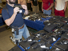 A stall employee checks a second hand gun at a show hosted at the Will rogers Memorial Center in Fort Worth.Dallas is a major city in Texas and is the largest urban center of the fourth most populous metropolitan area in the United States. The city ranks ninth in the U.S. and third in Texas after Houston and San Antonio. The city's prominence arose from its historical importance as a center for the oil and cotton industries, and its position along numerous railroad lines.For two weeks in the summer of 2015, photographer Peter Dench visited Dallas to document the metroplex in his epic reportage, DENCH DOES DALLAS.Photographed using an Olympus E-M5 Mark II©Peter Dench/Getty Images Reportage