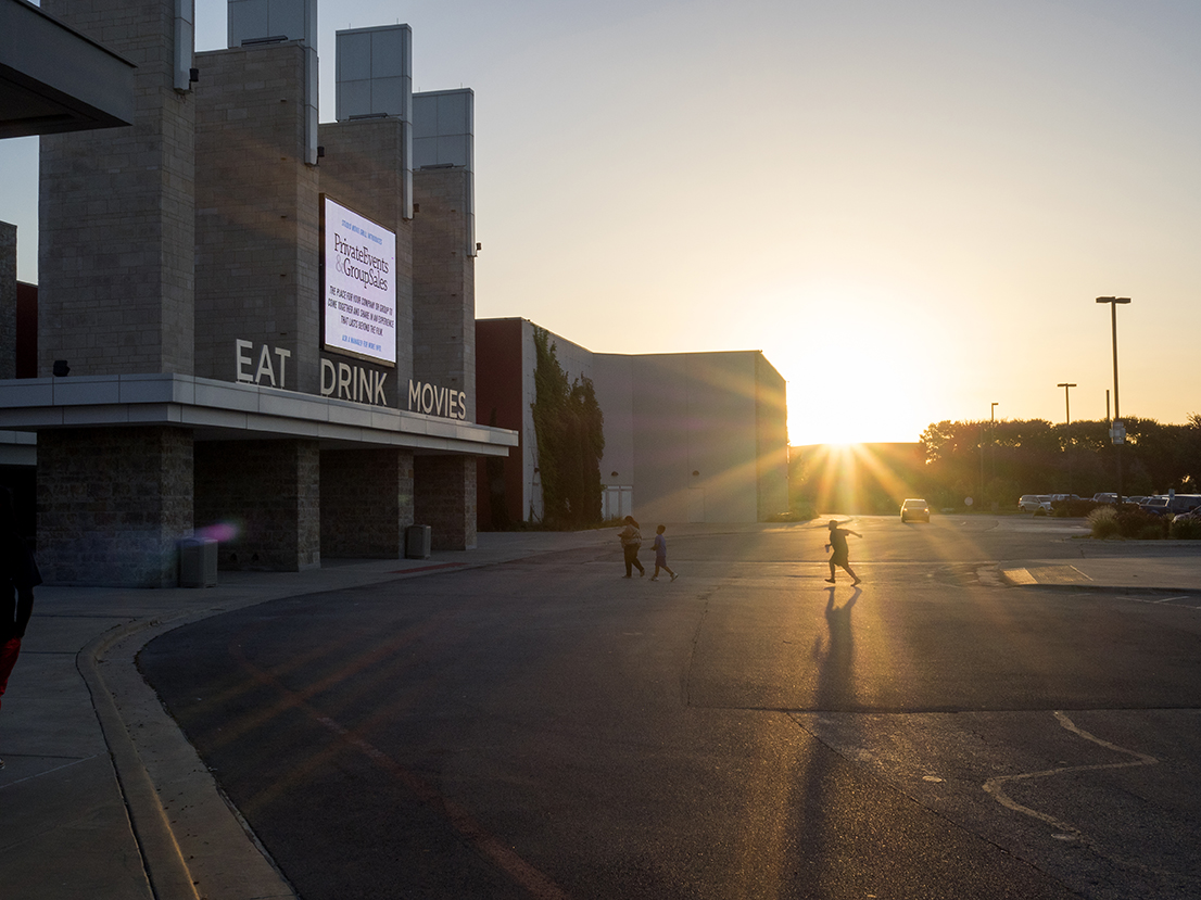 The sun sets over a cinema located on Technology Boulevard to the north west of downtown Dallas.Dallas is a major city in Texas and is the largest urban center of the fourth most populous metropolitan area in the United States. The city ranks ninth in the U.S. and third in Texas after Houston and San Antonio. The city's prominence arose from its historical importance as a center for the oil and cotton industries, and its position along numerous railroad lines.For two weeks in the summer of 2015, photographer Peter Dench visited Dallas to document the metroplex in his epic reportage, DENCH DOES DALLAS.Photographed using an Olympus E-M5 Mark II©Peter Dench/Getty Images Reportage