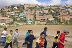 Children on the 'Goals For a Better Life' football programme train on a pitch at the foot of a slum on the outskirts of Bogota. Run by the 'Colombianito's' charity, it aims to use the kids passion for football to keep them in school and away from street gangs.In disaster areas, war zones and urban wastelands, football keeps humanity alive. It brings nations together and promotes unity. It encourages equality and generates pride and self-belief. It has the power to heal and to help, to motivate, to give freedom to dreams and empower a generation. There are millions of people playing the game or helping it to flourish who find that football brings a positive dimension to their lives.Away from the billionaire owned clubs with it's multi-million dollar players, Football's Hidden Story is a series of emotive human interest photographs showing the positive impact football has had at grassroot level on individuals and communities all around the world.