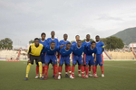 The Haitian under 17 team pose for a photograph before a match against the USA's Cleveland Cavalier's at the Sylvio Cator Stadium. They went on to win the game. In 1974 Haiti won a place at the World Cup Finals. 33 revolutionary years later the impoverished country's under 17 team played at the FIFA U-17 World Cup Finals in South Korea.In disaster areas, war zones and urban wastelands, football keeps humanity alive. It brings nations together and promotes unity. It encourages equality and generates pride and self-belief. It has the power to heal and to help, to motivate, to give freedom to dreams and empower a generation. There are millions of people playing the game or helping it to flourish who find that football brings a positive dimension to their lives.Away from the billionaire owned clubs with it's multi-million dollar players, Football's Hidden Story is a series of emotive human interest photographs showing the positive impact football has had at grassroot level on individuals and communities all around the world.