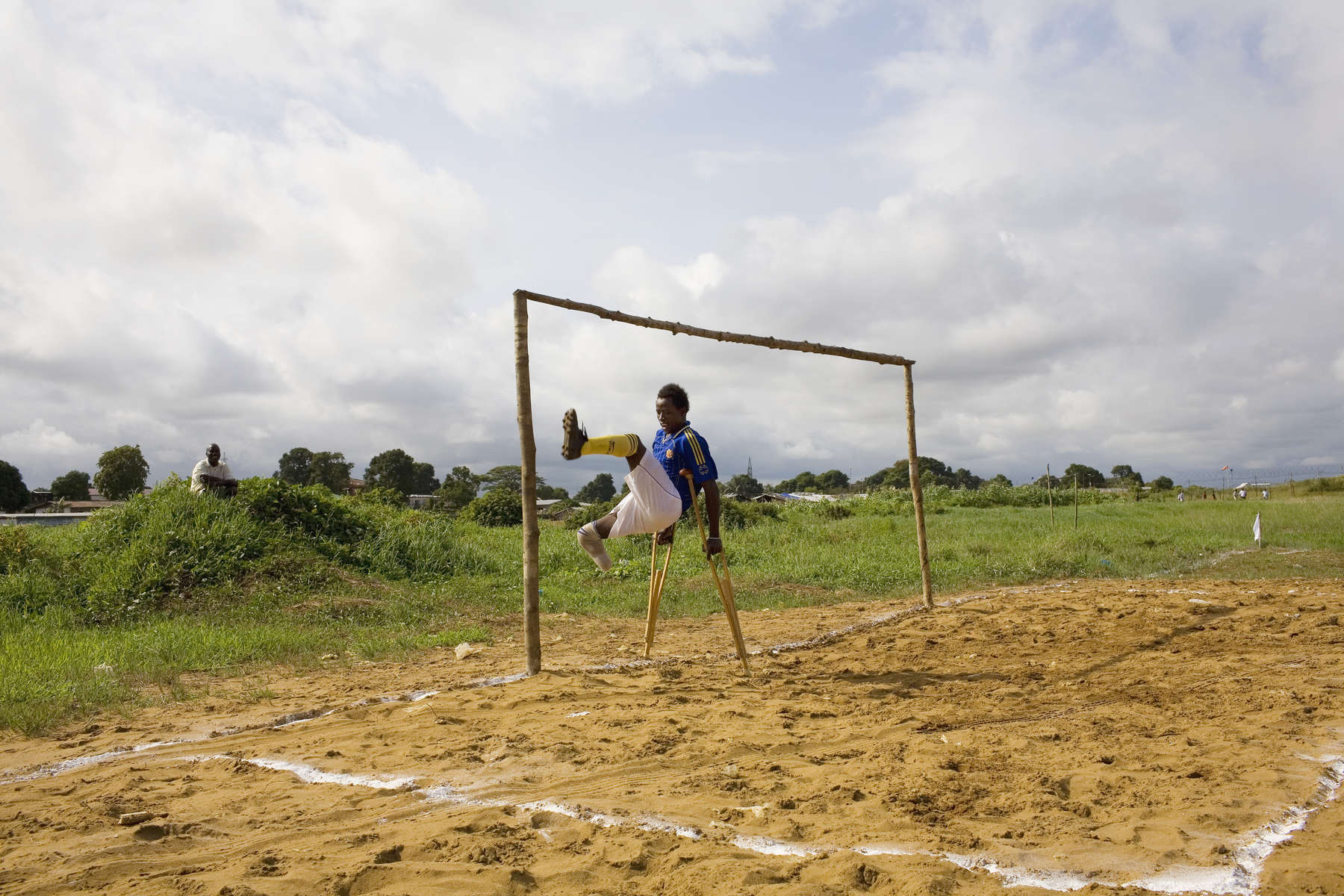 An amputee exercises on a pitch modified for amputee matches. The goal is half the size of the orthodox version.In disaster areas, war zones and urban wastelands, football keeps humanity alive. It brings nations together and promotes unity. It encourages equality and generates pride and self-belief. It has the power to heal and to help, to motivate, to give freedom to dreams and empower a generation. There are millions of people playing the game or helping it to flourish who find that football brings a positive dimension to their lives.Away from the billionaire owned clubs with it's multi-million dollar players, Football's Hidden Story is a series of emotive human interest photographs showing the positive impact football has had at grassroot level on individuals and communities all around the world.