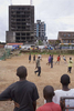 Kids play football in front of a burnt out building in the Liberian capital Monrovia. After over a decade of civil war, football is helping bring communities back together.In disaster areas, war zones and urban wastelands, football keeps humanity alive. It brings nations together and promotes unity. It encourages equality and generates pride and self-belief. It has the power to heal and to help, to motivate, to give freedom to dreams and empower a generation. There are millions of people playing the game or helping it to flourish who find that football brings a positive dimension to their lives.Away from the billionaire owned clubs with it's multi-million dollar players, Football's Hidden Story is a series of emotive human interest photographs showing the positive impact football has had at grassroot level on individuals and communities all around the world.