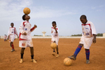 Football training in progress on the red dirt at the Diambar's football academy a 2 hour drive from the Senegalise capital Dakar. Founded in 2003, the academy is home to 90 former street kids aged 13-18.In disaster areas, war zones and urban wastelands, football keeps humanity alive. It brings nations together and promotes unity. It encourages equality and generates pride and self-belief. It has the power to heal and to help, to motivate, to give freedom to dreams and empower a generation. There are millions of people playing the game or helping it to flourish who find that football brings a positive dimension to their lives.Away from the billionaire owned clubs with it's multi-million dollar players, Football's Hidden Story is a series of emotive human interest photographs showing the positive impact football has had at grassroot level on individuals and communities all around the world.