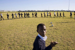 Kids on the Grassroot Soccer programme at a school in Cape Town. The idea is to develop a curriculum for HIV/AIDS education based on games. Football attracts kids and the the message from the game can easily be transferred to life.In disaster areas, war zones and urban wastelands, football keeps humanity alive. It brings nations together and promotes unity. It encourages equality and generates pride and self-belief. It has the power to heal and to help, to motivate, to give freedom to dreams and empower a generation. There are millions of people playing the game or helping it to flourish who find that football brings a positive dimension to their lives.Away from the billionaire owned clubs with it's multi-million dollar players, Football's Hidden Story is a series of emotive human interest photographs showing the positive impact football has had at grassroot level on individuals and communities all around the world.