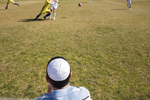 A Jewish fan watches a football match between Katamon Abu Ghosh Mevaseret FC, a mixture of Arabs and Jewsish players, and a team of Druze from the occupied Golan Heights, the first ever Syrian-born football team to play in Israel.In disaster areas, war zones and urban wastelands, football keeps humanity alive. It brings nations together and promotes unity. It encourages equality and generates pride and self-belief. It has the power to heal and to help, to motivate, to give freedom to dreams and empower a generation. There are millions of people playing the game or helping it to flourish who find that football brings a positive dimension to their lives.Away from the billionaire owned clubs with it's multi-million dollar players, Football's Hidden Story is a series of emotive human interest photographs showing the positive impact football has had at grassroot level on individuals and communities all around the world.