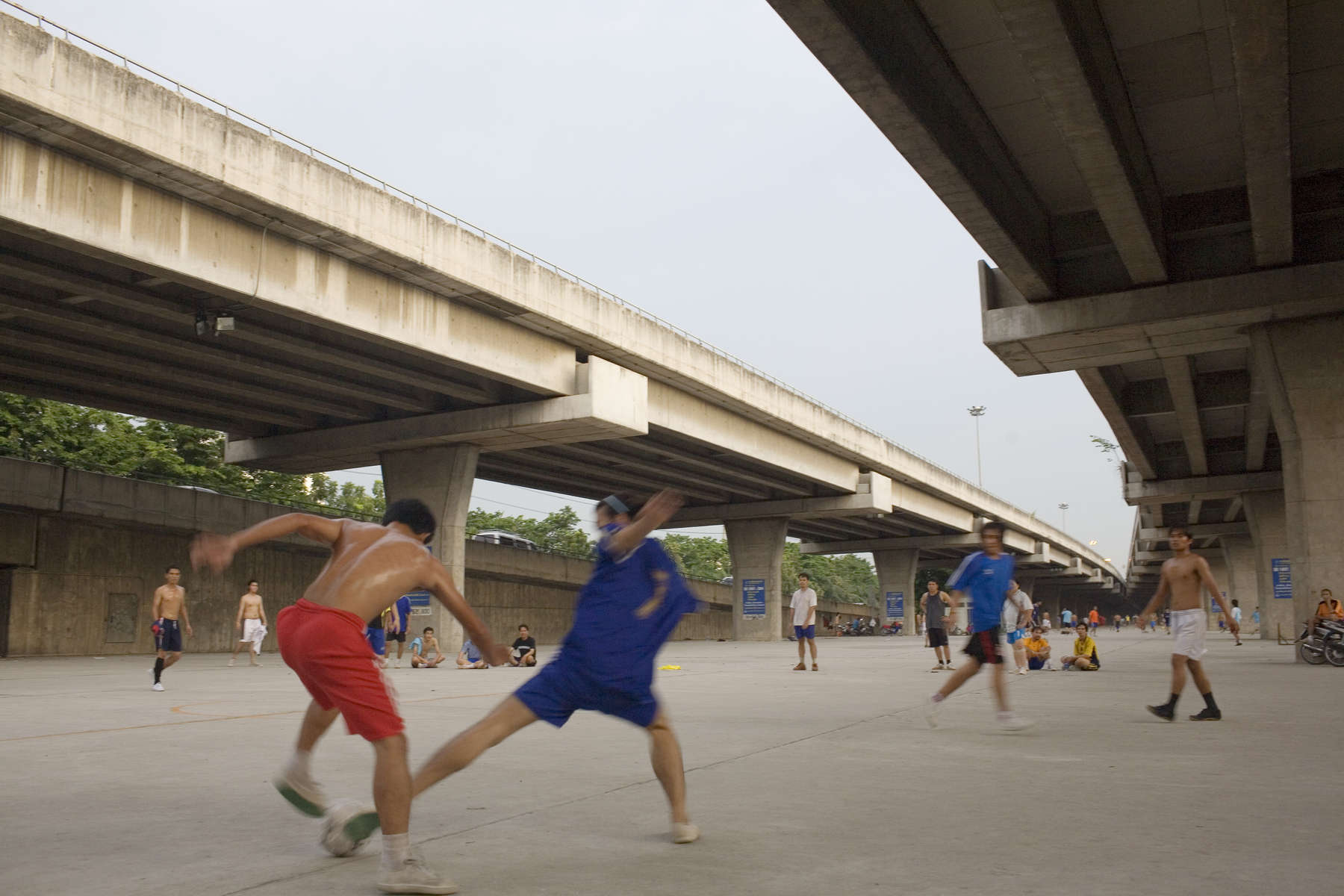 A Futsal match being played under a flyover in the Thai capital Bangkok. There are over 10,000 teams in Thailand, part of the success of the sport is due to the fact that it can be played in a small place.In disaster areas, war zones and urban wastelands, football keeps humanity alive. It brings nations together and promotes unity. It encourages equality and generates pride and self-belief. It has the power to heal and to help, to motivate, to give freedom to dreams and empower a generation. There are millions of people playing the game or helping it to flourish who find that football brings a positive dimension to their lives.Away from the billionaire owned clubs with it's multi-million dollar players, Football's Hidden Story is a series of emotive human interest photographs showing the positive impact football has had at grassroot level on individuals and communities all around the world.