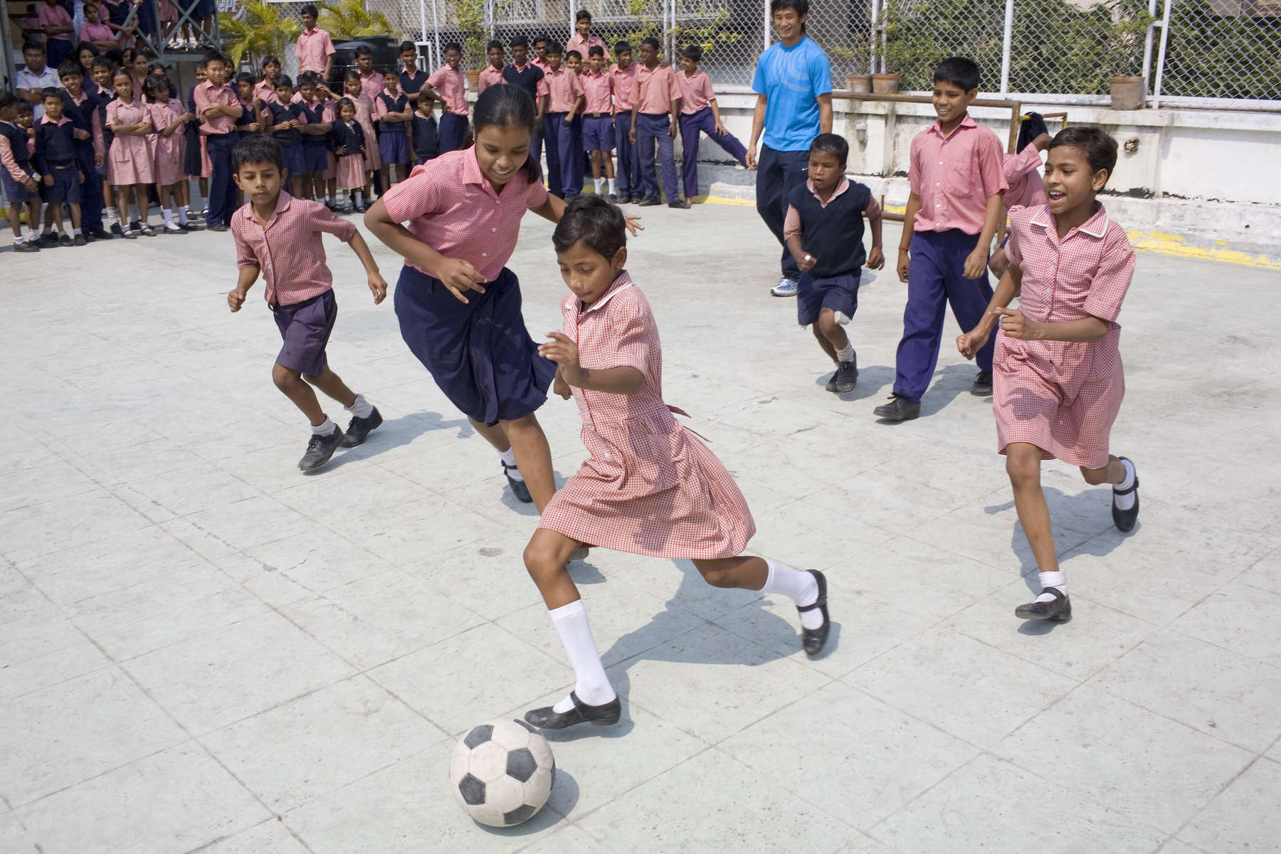School kids play a game of football during a break from lessons at the Future Hope school in Kolkata. Football has always played a major role at the school. Through the sport the kids learn discipline and a sense of purpose. Set up over 18 years ago, it provides a home, education and medical aid to some of the children who found themselves living on the streets of the city.In disaster areas, war zones and urban wastelands, football keeps humanity alive. It brings nations together and promotes unity. It encourages equality and generates pride and self-belief. It has the power to heal and to help, to motivate, to give freedom to dreams and empower a generation. There are millions of people playing the game or helping it to flourish who find that football brings a positive dimension to their lives.Away from the billionaire owned clubs with it's multi-million dollar players, Football's Hidden Story is a series of emotive human interest photographs showing the positive impact football has had at grassroot level on individuals and communities all around the world.