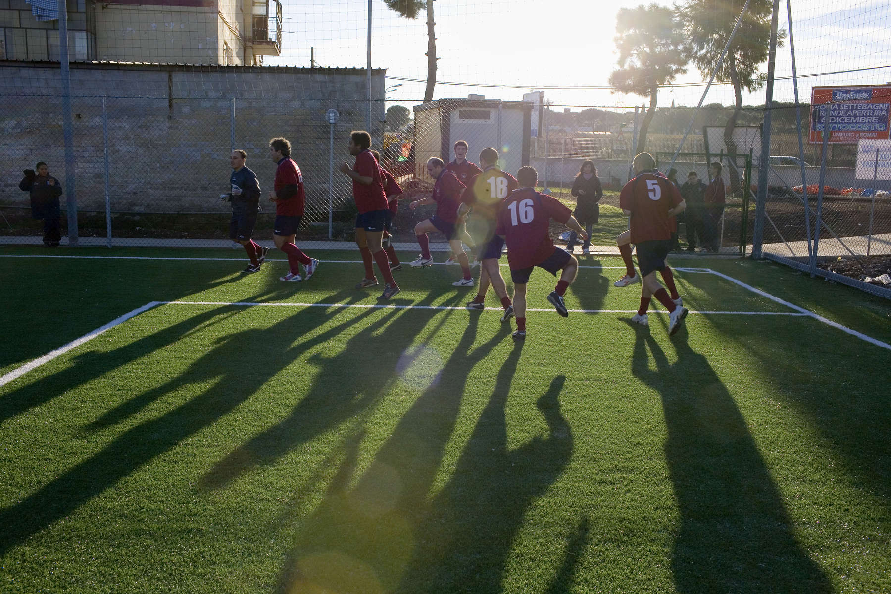 Players of the Gabbiano football club in Rome warm up before a match. Half of the players are schizophrenics. The club performs a startling and successful form of psychiatric therapy. In disaster areas, war zones and urban wastelands, football keeps humanity alive. It brings nations together and promotes unity. It encourages equality and generates pride and self-belief. It has the power to heal and to help, to motivate, to give freedom to dreams and empower a generation. There are millions of people playing the game or helping it to flourish who find that football brings a positive dimension to their lives.Away from the billionaire owned clubs with it's multi-million dollar players, Football's Hidden Story is a series of emotive human interest photographs showing the positive impact football has had at grassroot level on individuals and communities all around the world.