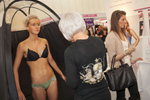 A young women receives a free spray tan at the award winning best fake tan & spray tan supplier,   Lauren's Way, at an Expo in London.©Peter Dench/Getty Images Reportage