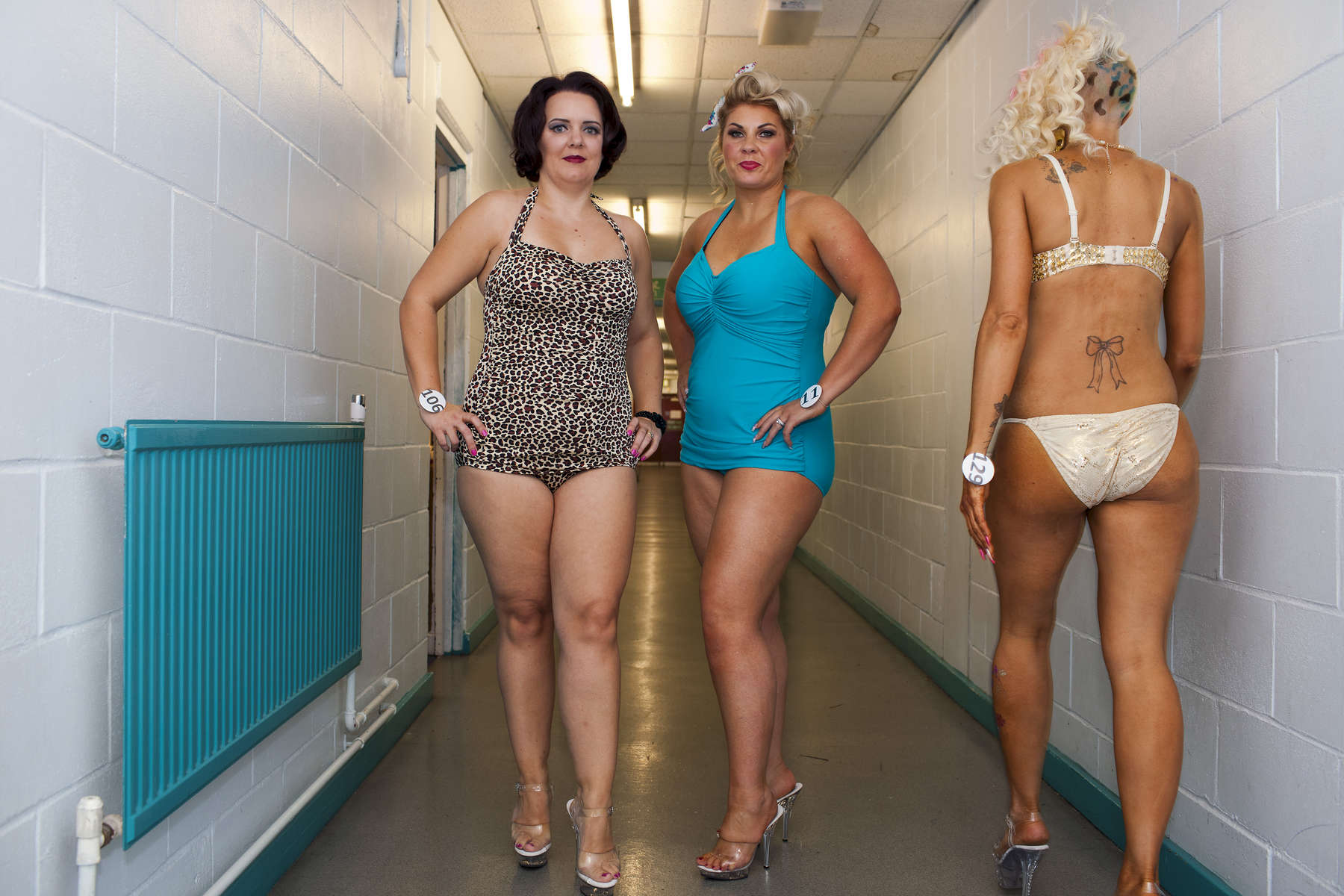 Victoria Coventry; Alice Burgoyne; Jemma DunnMiss Galaxy Universe is an all female fitness show based around performance and functionality; also offering the industry standard of bikini rounds, but adding a touch of showgirl elegance to the stage.©Peter Dench/Getty Images Reportage