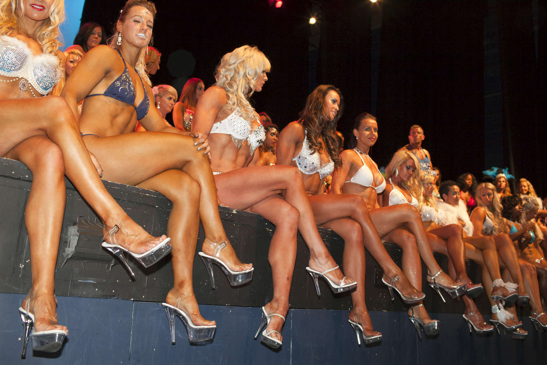 Miss Galaxy Universe is an all female fitness show based around performance and functionality; also offering the industry standard of bikini rounds, but adding a touch of showgirl elegance to the stage.©Peter Dench/Getty Images Reportage