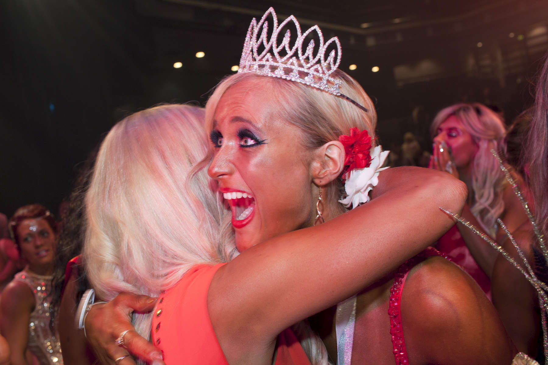Amy Claire Short celebrates becoming new 'Fall Classic' Miss Galaxy Universe Supreme Champion 2014.Miss Galaxy Universe is an all female fitness show based around performance and functionality; also offering the industry standard of bikini rounds, but adding a touch of showgirl elegance to the stage.©Peter Dench/Getty Images Reportage
