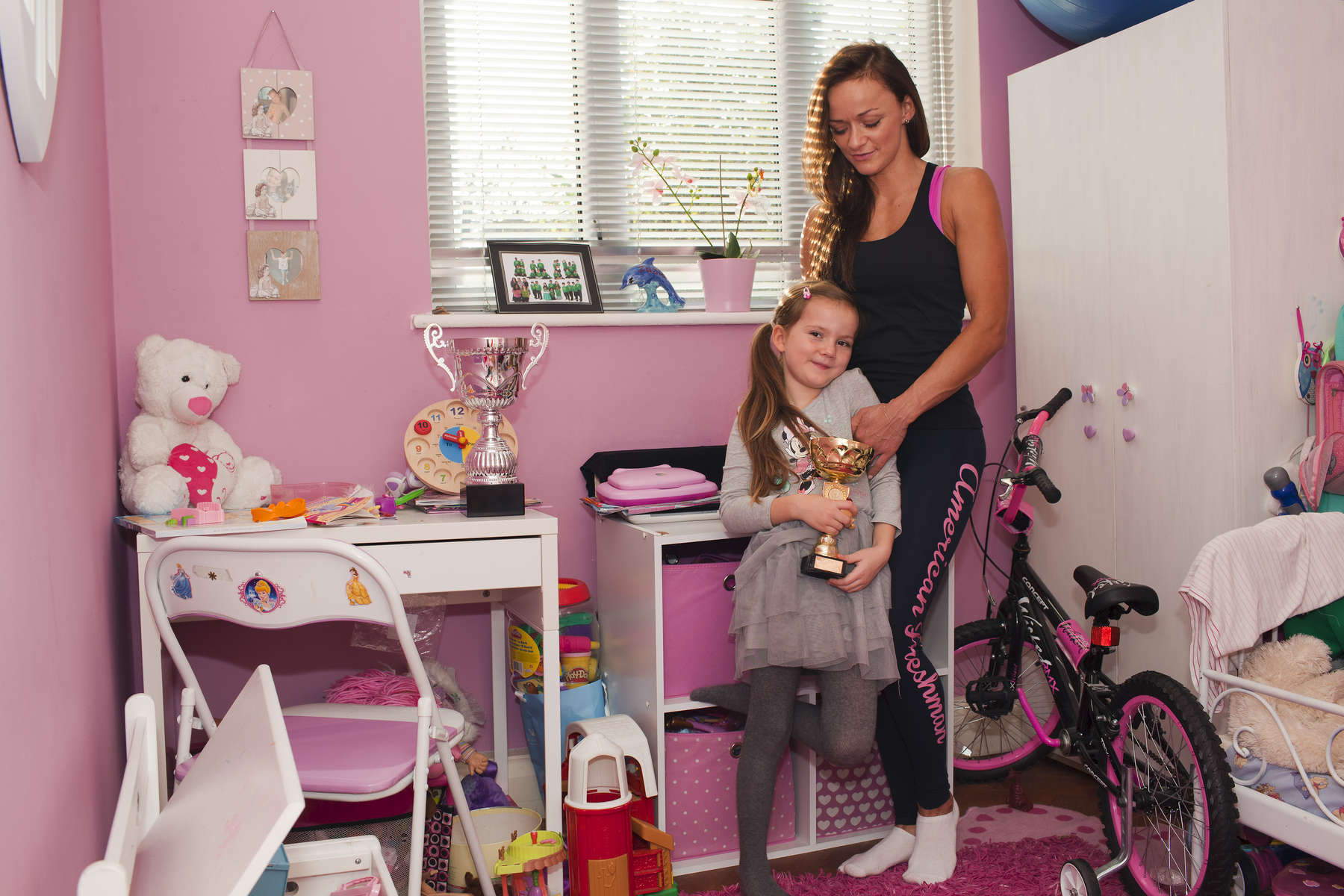 Fitness Model Aleksandra Aleksandra with her six year old daughter in their north London home. Aleksandra placed first in the 2014 Musclemania Ms. Bikini Britain Show Tall category hosted at The Shaw Theatre, London.©Peter Dench/Getty Images Reportage