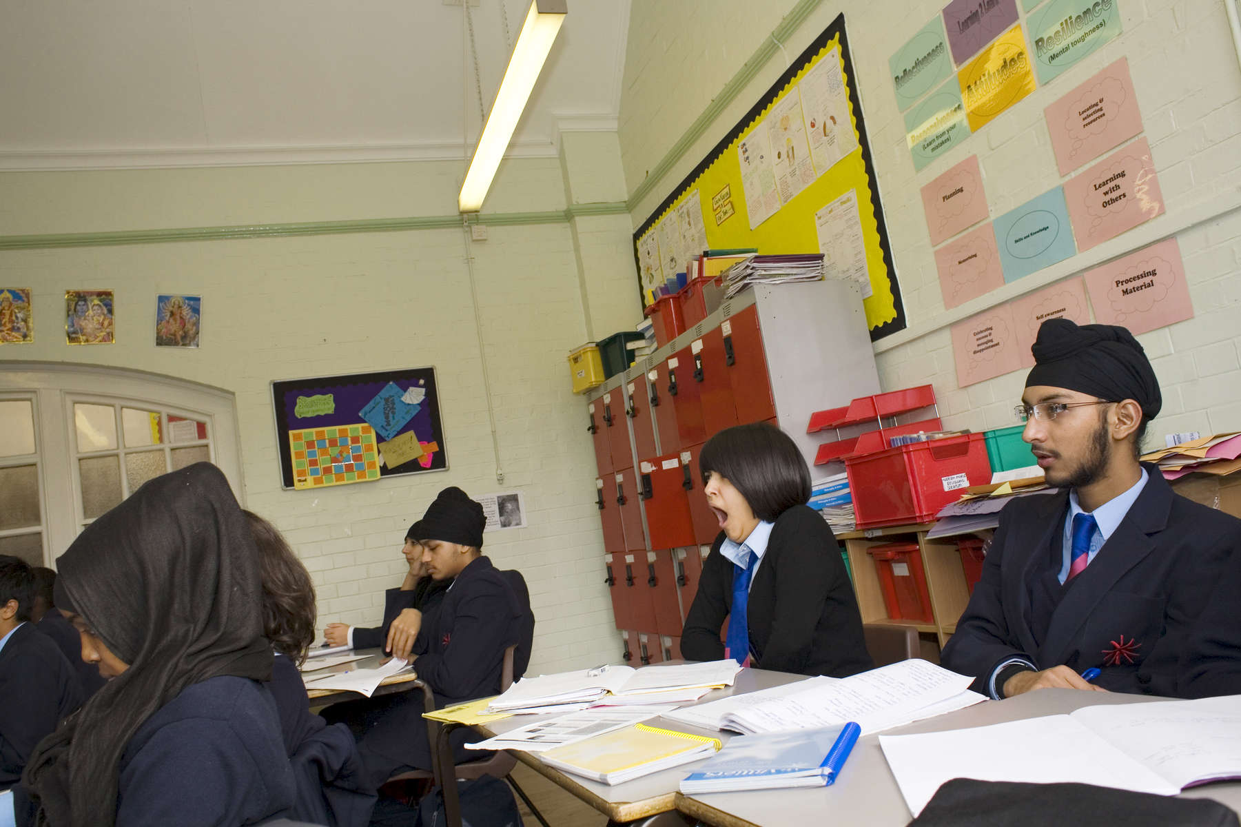 15 year old Robyn Kullar whose family are Sikh in a Religious Education class learning about aspects of Islam.Villiers High School is in the town of Southall. It has a very wide ethnic diversity. 45 different 1st spoken languages are listed among the 1208 pupils. 25 ethnic groups are represented with Indian, Pakistani and Black-Somali the three highest.Southall is a suburban district of West London, England. The town has one of the largest concentrations of South Asian people outside of the Indian sub-continent. Over 55% os Southall's population of 70,000 is Indian/Pakistani, with less than 10% being White British.