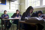 15 year old year 11 pupil Laiba Abassi (2nd left) in a Maths lesson at Villiers High School. She is studying hard in class for her mock GCSE exams.Villiers High School is in the town of Southall. It has a very wide ethnic diversity. 45 different 1st spoken languages are listed among the 1208 pupils. 25 ethnic groups are represented with Indian, Pakistani and Black-Somali the three highest.Southall is a suburban district of West London, England. The town has one of the largest concentrations of South Asian people outside of the Indian sub-continent. Over 55% os Southall's population of 70,000 is Indian/Pakistani, with less than 10% being White British.