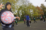 The Tuesday after school netball club in action on one of the outside courts at Villiers High School. Staff at Villiers urge parents to actively encourage their children to attend at least one extra curricular club. Netball is particularly popular with female pupils from South Asia.Villiers High School is in the town of Southall. It has a very wide ethnic diversity. 45 different 1st spoken languages are listed among the 1208 pupils. 25 ethnic groups are represented with Indian, Pakistani and Black-Somali the three highest.Southall is a suburban district of West London, England. The town has one of the largest concentrations of South Asian people outside of the Indian sub-continent. Over 55% os Southall's population of 70,000 is Indian/Pakistani, with less than 10% being White British.