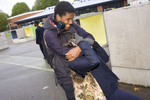 15 year old Robyn Kullar messes around with Omar Austin during her lunchtime break at Villers High School.Villiers High School is in the town of Southall. It has a very wide ethnic diversity. 45 different 1st spoken languages are listed among the 1208 pupils. 25 ethnic groups are represented with Indian, Pakistani and Black-Somali the three highest.Southall is a suburban district of West London, England. The town has one of the largest concentrations of South Asian people outside of the Indian sub-continent. Over 55% os Southall's population of 70,000 is Indian/Pakistani, with less than 10% being White British.