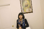 15 year old Robyn Kullar under a portrait of Sri Guru Gobind Singh at her home in Southall where she lives with her mother Sarbjeet (40), grandmother Kuldeep (59) and sister Alisha (13). Her family are Sikh but Robyn admits to being an Atheist. She enjoys the cultural aspects of Sikhism and will celebrate various festivals including Diwali.  Robyn is a pupil at Villiers High School.Villiers High School is in the town of Southall. It has a very wide ethnic diversity. 45 different 1st spoken languages are listed among the 1208 pupils. 25 ethnic groups are represented with Indian, Pakistani and Black-Somali the three highest.Southall is a suburban district of West London, England. The town has one of the largest concentrations of South Asian people outside of the Indian sub-continent. Over 55% os Southall's population of 70,000 is Indian/Pakistani, with less than 10% being White British.