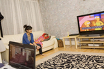 15 year old Laiba Abassi watching an episode of TV favourite The Simpsons with her sister Fatimah (3). Her sister Ahareem (10) is playing card game patience on the computer. Laiba has another sister Maira (14), they both attend Villiers High School.Villiers High School is in the town of Southall. It has a very wide ethnic diversity. 45 different 1st spoken languages are listed among the 1208 pupils. 25 ethnic groups are represented with Indian, Pakistani and Black-Somali the three highest.Southall is a suburban district of West London, England. The town has one of the largest concentrations of South Asian people outside of the Indian sub-continent. Over 55% os Southall's population of 70,000 is Indian/Pakistani, with less than 10% being White British.