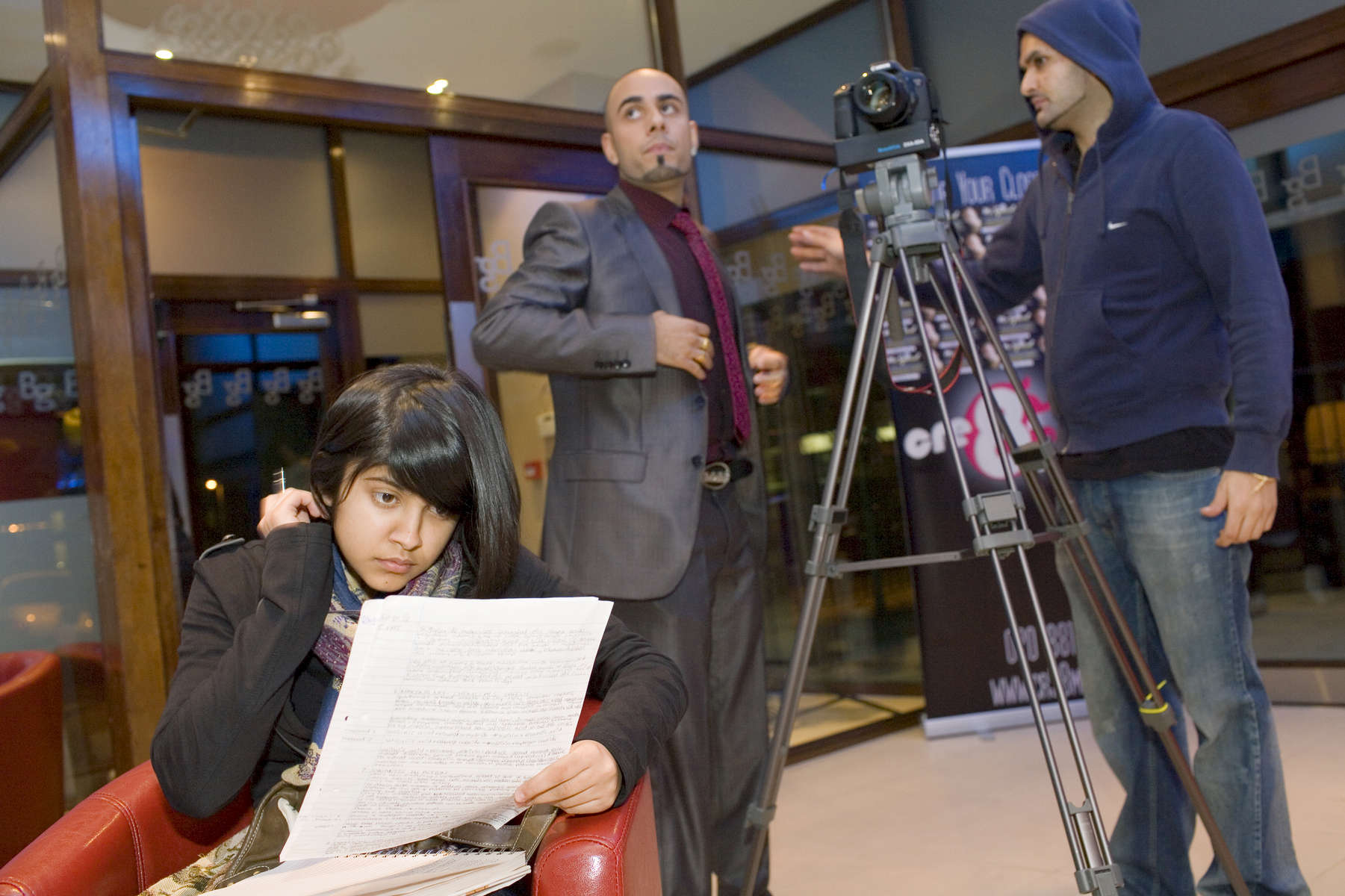 15 year old Robyn Kullar studying for a Science Exam at the filming of a music video for Bhangra sensation MC Special (centre), her uncle, Blaise (right) is the director. Robyn hopes to go on to study photography at college. Villiers High School is in the town of Southall. It has a very wide ethnic diversity. 45 different 1st spoken languages are listed among the 1208 pupils. 25 ethnic groups are represented with Indian, Pakistani and Black-Somali the three highest.Southall is a suburban district of West London, England. The town has one of the largest concentrations of South Asian people outside of the Indian sub-continent. Over 55% os Southall's population of 70,000 is Indian/Pakistani, with less than 10% being White British.