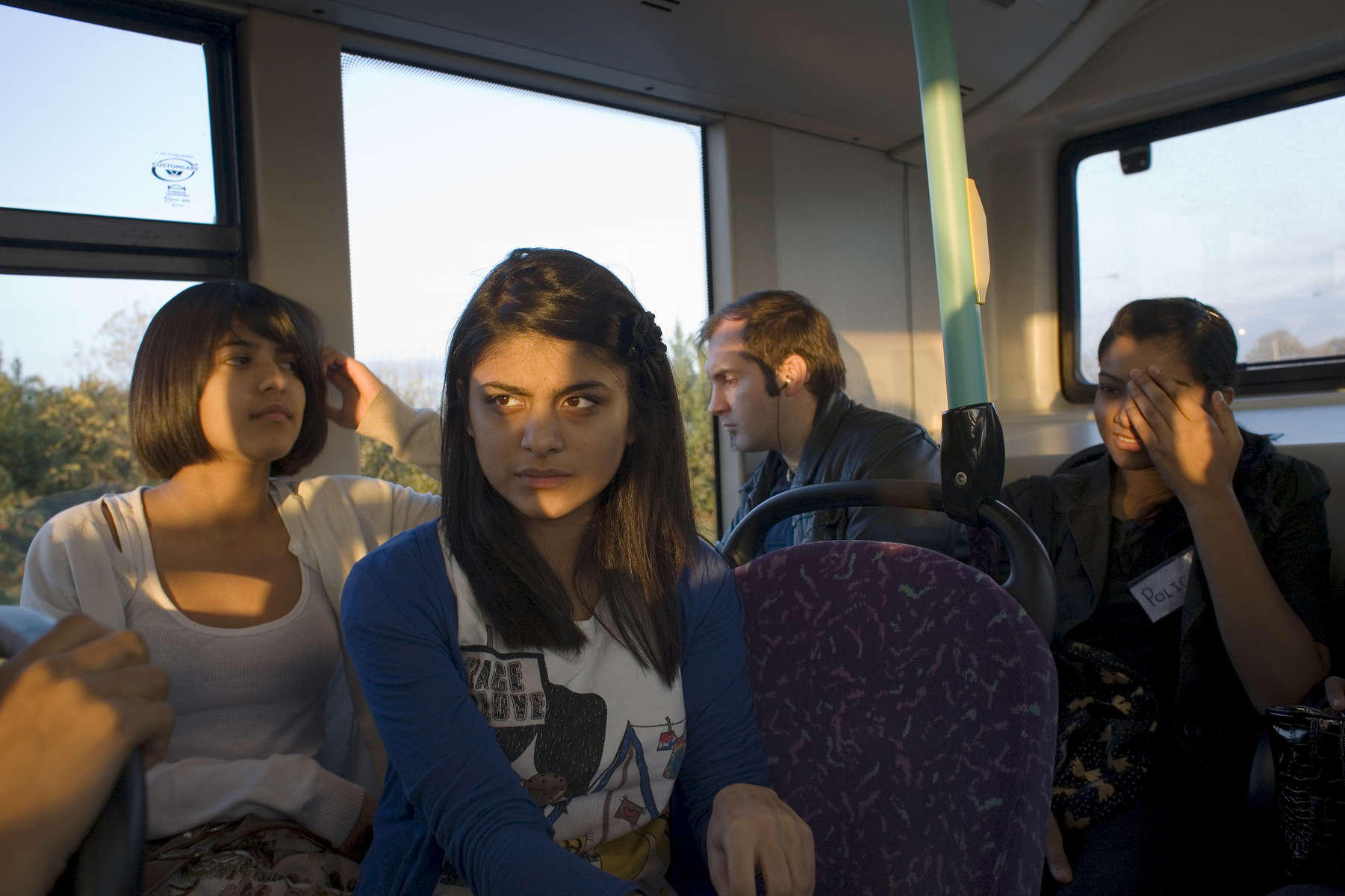 Laiba Abassi (2nd right) and Robyn Kullar (left) on the bus to The Beck Theatre where Laiba will perfom as Adriana and Robyn as Luciana in a production of William Shakespeare's 'Comedy of Errors' as part of the 10th Anniversary Shakespeare School Festival. Laiba (15) a Muslim and Robyn Kullar (15) a Sikh are very close friends and pupils at Villiers High School in Southall.Villiers High School is in the town of Southall. It has a very wide ethnic diversity. 45 different 1st spoken languages are listed among the 1208 pupils. 25 ethnic groups are represented with Indian, Pakistani and Black-Somali the three highest.Southall is a suburban district of West London, England. The town has one of the largest concentrations of South Asian people outside of the Indian sub-continent. Over 55% os Southall's population of 70,000 is Indian/Pakistani, with less than 10% being White British.